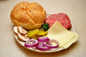 Cheeseburger Ingredients with A fresh Roll — Stock Photo