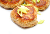Close Up of Fish Cakes with Sliced scallions — Stock Photo
