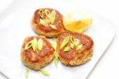 Fish Cakes Served with Lemon and Scallions — Stock Photo