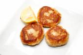 Fried Salmon Cakes with a Wedge of Lemon — 图库照片