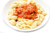 Tomato Bolognese Sauce on Cooked Pasta Shells — Stock Photo