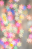Blurred bokeh snowflakes background — Stock Photo