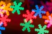 Blurred bokeh snowflakes background — Stock Photo