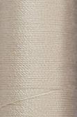 Spolen i beige tråd — Stockfoto
