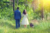 Young newlyweds with dog — Foto Stock