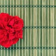 Bamboo pad decorated with flower — Stock Photo #62332163