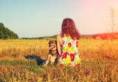 Woman with dog in field — Stock Photo