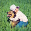 Happy girl with dog — Stock Photo #64037229