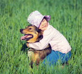 Happy girl with dog — Stock Photo
