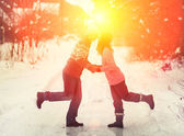Couple  kissing outdoors in snowy winter — Stock Photo