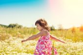 Little girl on field — Stock Photo