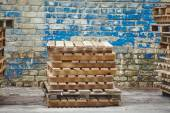 Wooden pallets on background wooden wall — Stockfoto