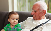 Baby boy with great grandfather — Photo