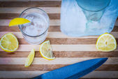 Glass of vodka with lemon slices — Stock Photo