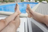Swimming pool legs — Stock Photo