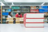 A pile of books with library on the back — Stock Photo