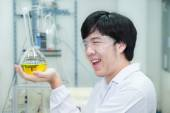 Asian researcher carrying out experiments in a laboratory - look — Stock Photo