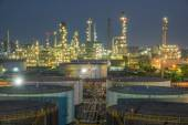 Oil refinery at dramatic twilight — Stock Photo