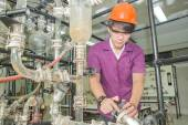 Engineer student turning pipeline pump for training in laborator — Stock Photo