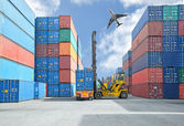 Crane lifter handling container box loading to truck — Stock Photo