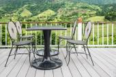 Table and chair on terrace with nature in background — Stock Photo