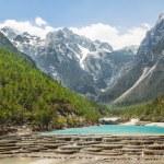 White Water River waterfall and Jade Dragon Snow Mountain, Lijia — Stock Photo #52363787