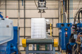 Industrial robot working in factory — Stock Photo