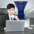 Asian businessman drinking coffee and working with computer in m — Stock Photo #53684481