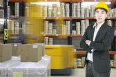 Manager asian business in modern warehouse — Stock Photo