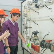 Chemical engineer student checking equipment in control room for — Stock Photo #55022433
