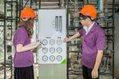 Chemical engineer student checking equipment in control room for — Stock Photo