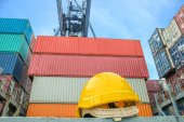 Yellow safety helmet on container ship — Stock Photo