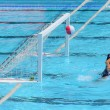 A water polo goalkeeper misses the ball going into the net of th — Stock Photo #58023695