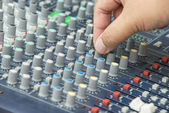 An expert adjusting audio mixing console — Stock Photo