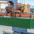 Shore crane loading containers in freight ship (selective focus) — Stock Photo #59493519