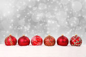 Christmas balls and snow on abstract background — Stockfoto