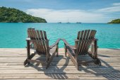 Two beach chairs placed on wooden floor at the sea view — Stock Photo