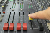 Finger pushing a mixing desk slide. Selective focus — Foto de Stock