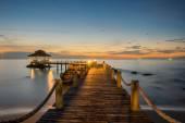 Landscape of Wooded bridge pier between sunset — Stock Photo