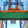 Shore crane loading containers in freight ship — Stock Photo #63014381