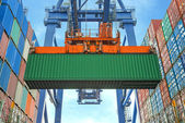 Shore crane loading containers in freight ship — Stock Photo