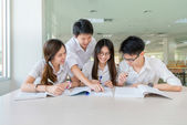 Group of asian students in uniform studying together at classroo — Stock Photo