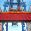 Shore crane loading containers in freight ship — Stock Photo #78247670