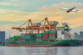 Container Cargo freight ship with working crane loading bridge i — Stock Photo
