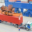 Container truck waiting for loading container box to Cargo ship — Stock Photo #78680120