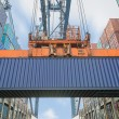 Shore crane loading containers in freight ship — Stock Photo #78680258