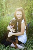 Beautiful red hair women  girl with brown doberman pinscher dog — Stock Photo