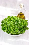 Fresh lettuce salad and olive oil, selective focus — Stock Photo