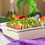 Preparing vegetable ratatouille gratin, selective focus — Stock Photo #59726929