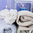 Warm scarfs with candles, selective focus — Stock Photo #59727175